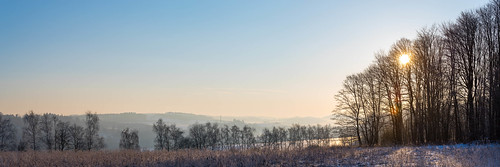 frozen country cold winter snow trees sunrise blue sky panorama landscape