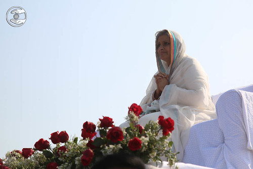 Her Holiness on a flower bedecked open carriage