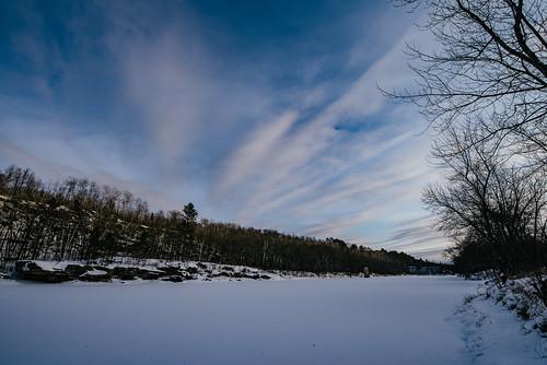 kettleriver minnesota robinsonpark frozen frozenriver ice river sandstone sky snow sunset winter unitedstates us