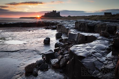bamburgh bamburghcastle landscapephotography northumbria petebarnesphotography castle castleatsunset coast dunes northumbriacoast sun sunrise sunset