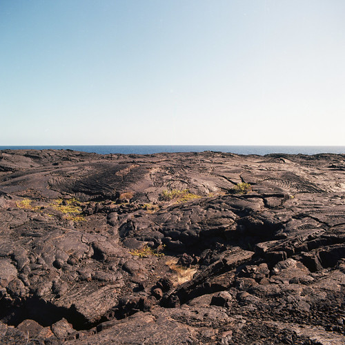 "Image titled ""Volcanic Rock and the Sea, Volcano National Park."""