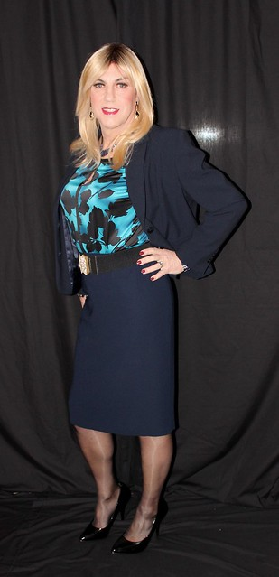Navy skirt suit and printed silk top.