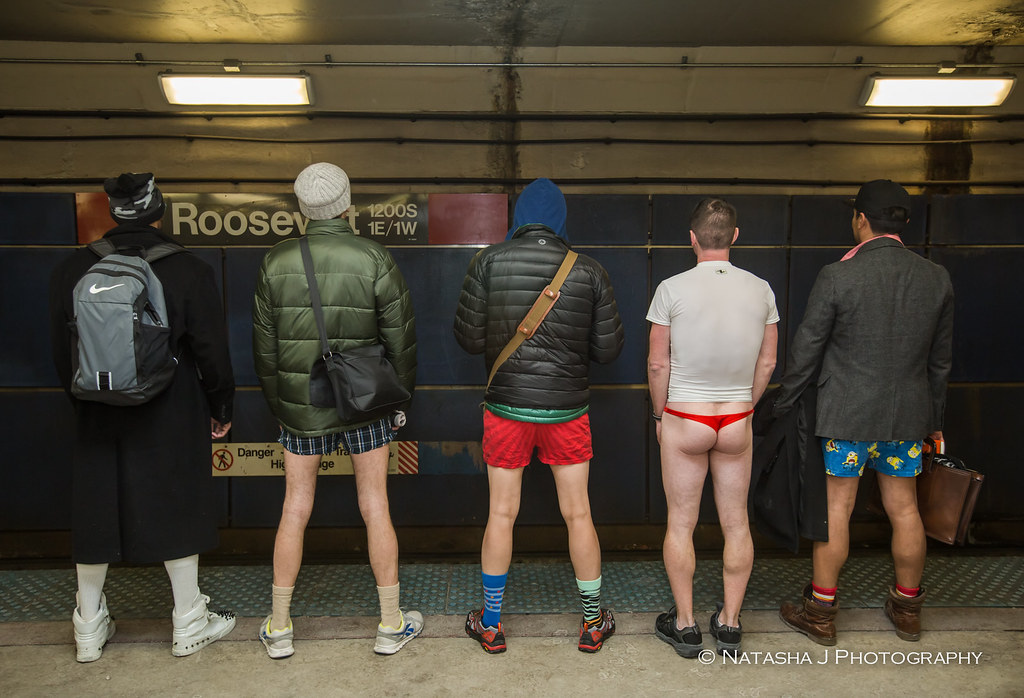 Passengers riders take off their trousers as part of the