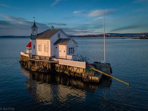 lighthouse navigationaid drone sunrise winter restaurant water closed sunsrise calm quiet coast building sea oslo norway no