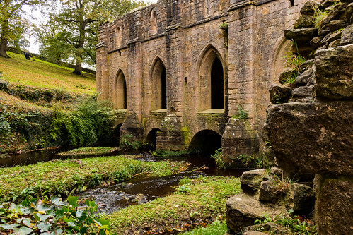 fountainsabbey laybrothers refectory dormitory dorter ruin remains building architecture ripon yorkshire abbey monastery ancient arch river water grass tree field wall stonework window butress landscape nationaltrust heritage
