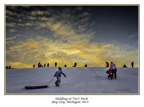 snow sled sledding winter hill slope slopes vets baycity kids fun sunset brilliantsky clouds yellowcolor yellow color tacphotography tomclark d5100 nikon nikoncamera tomclarknet