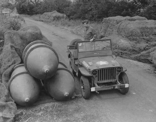 A member of the 2107th Ordinance-Ammo Battalion inspecting a store of 4000-pound bombs