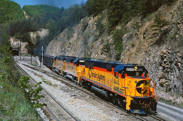 CHESSIE SYSTEM TRAIN #92 IS DOWN TO A CRAWL AS IT EXITS THE TUNNEL - ALLEGHANY, VIRGINIA - MAY 4, 1985
