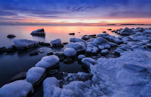 ice snow rocks horizon sunset sea seashore seascape sky seaside winter january cold frost freezing frozen bluehour darkening dusk water landscape serene peaceful lauttasaari helsinki finland