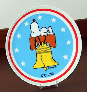Vintage Peanuts '76 Bicentennial Commemorative Plate Featuring Snoopy By Charles Schulz, Produced By Schmid Brothers, Measures 7.5 Inches In Diameter, Made In Japan, Circa 1976