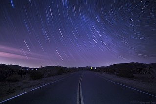 Star trails above road | by Abhranil Das