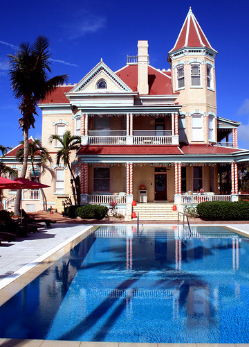 southernmosthouse inthecontinentalus historicinn usa florida unitedstates keywestflorida 1400duvalstreet monroecounty 5presidentsstayedhere built1896 for250000 privateresidence 1939~cubannightclub cafecayohueso backtoaresidencefrom1954to1996 1996~3millionrenovation toaneighteenroomhotel southernmosthousehistoricinn northernroofdesign~slopedforsnowfall ithasneversnowedinkeywest veryelegant building architecture pool sky outdoor beachhouse victorianstylemansion oldtownkeywest tree water winterinflorida tourists waterfront widowswalk balcony victorianmansion 18rms bedbreakfast 1896 palmtreeshadow bright irmasurvivor vertical palmtree silhouette