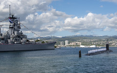 Sailors aboard USS Missouri (SSN 780) render honors to the Battleship Missouri Memorial while arriving at Joint Base Pearl Harbor-Hickam, Jan. 26. (U.S. Navy/MC2 Michael H. Lee)