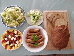 Julia's braised cabbage, sausages, Caprese salad, cucumber, bread