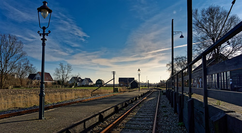 railroadtrack transportation train steel station sky travel outdoors railroadstationplatform metal industry freighttransportation ironmetal nopeople modeoftransport blue vanishingpoint sunset diminishingperspective dusk