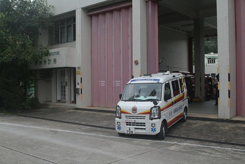 Miniature ambulance departs the full sized fire station on Peng Chau