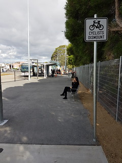 "A sure sign of a poorly designed bike path, the ""cyclists dismount"" sign 