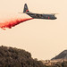 Firefighters watch a C-130J Hercules assigned to the 146th Airlift Wing based at Channel Islands Air National Guard Base in Port Hueneme, California, drop fire retardant chemicals onto a ridge line above Santa Barbara, Dec. 13, 2017, as part of efforts to contain the Thomas Fire. (U.S. Air Force photo by J.M. Eddins Jr.)