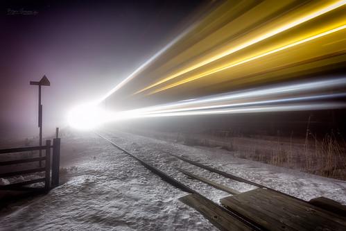 fog diagonallines headlights lightbeams lighttrails mist railcrossing railroad railway snow speedoflight speedstripes tracks train vestfold norway no