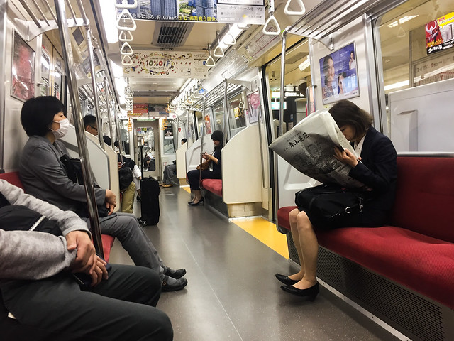 People sitting in JR subway train