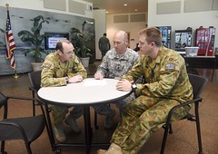 Warrant Officer Class 2 Steve Davies and Corporal Andrew Hume of the Australian Regular Army and Lt. Col. Paul Sellars of the U.S. Army work together at the combined exercise control group (CECG) on Ford Island at Joint Base Pearl Harbor-Hickam during exercise Talisman Sabre. (U.S. Navy/MC2 Brian Wilbur)