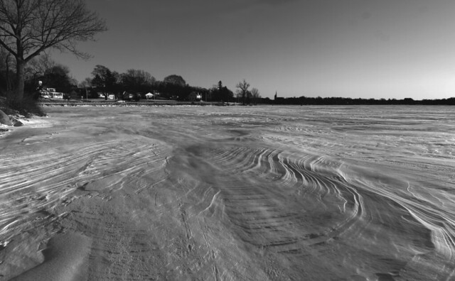 snow drifts on frozen lake quannapowitt, wakefield