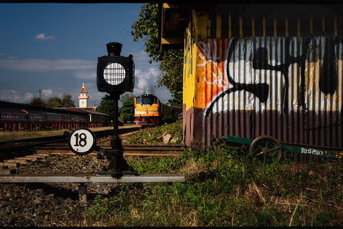 staterailwayofthailand chiangmaithailand srt railroad approachingtrain passengertrain trackside switch shed signal grafitti station platforms sidings tracks rails ballast locomotive landscape eighteen 18 hut clutter signage equipment transportation rusty random yard chiangmairailwaystation thai asian siam southeastasia urban shack cart framing colorful siu rust weeds metal cityscape nikond5100 tamron18270 photoshopbyfehlfarben thanksbinexo