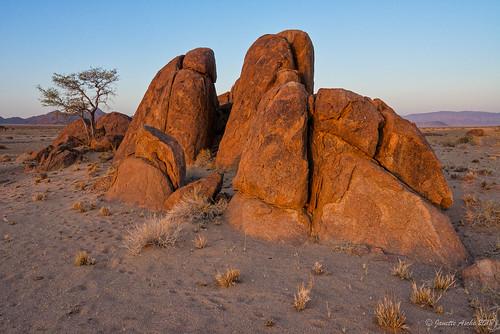 2017 africa desertquivercamp kibokoadventures namibia sossusvlei arid desert granite landscape rocks sand sunset travel light boulders geology