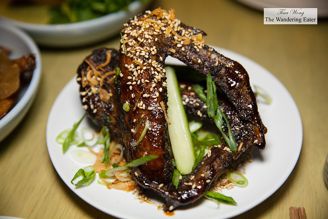 Duck wings, palm sugar glaze, cucumbers, scallions, sesame