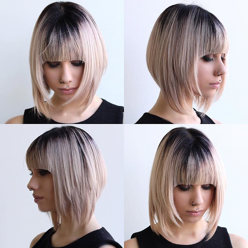 Blonde Razor Cut Angled Bob with Full Blunt Bangs and Black Shadow Root