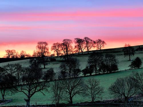 derbyshiredalesdistrict england unitedkingdom gb gratton sunrise pink red green trees blue beautiful scenery landscape rural outdoors hills countryside peakdistrict