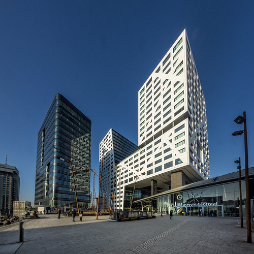 architecture utrecht cityscape city blue bright contrast netherlands nederland outdoors outdoor panorama provincieutrecht sony sky sun thenetherlands ultrawide wimvandem train centraltrainstation cityhall cityoffice moderncity golddragon