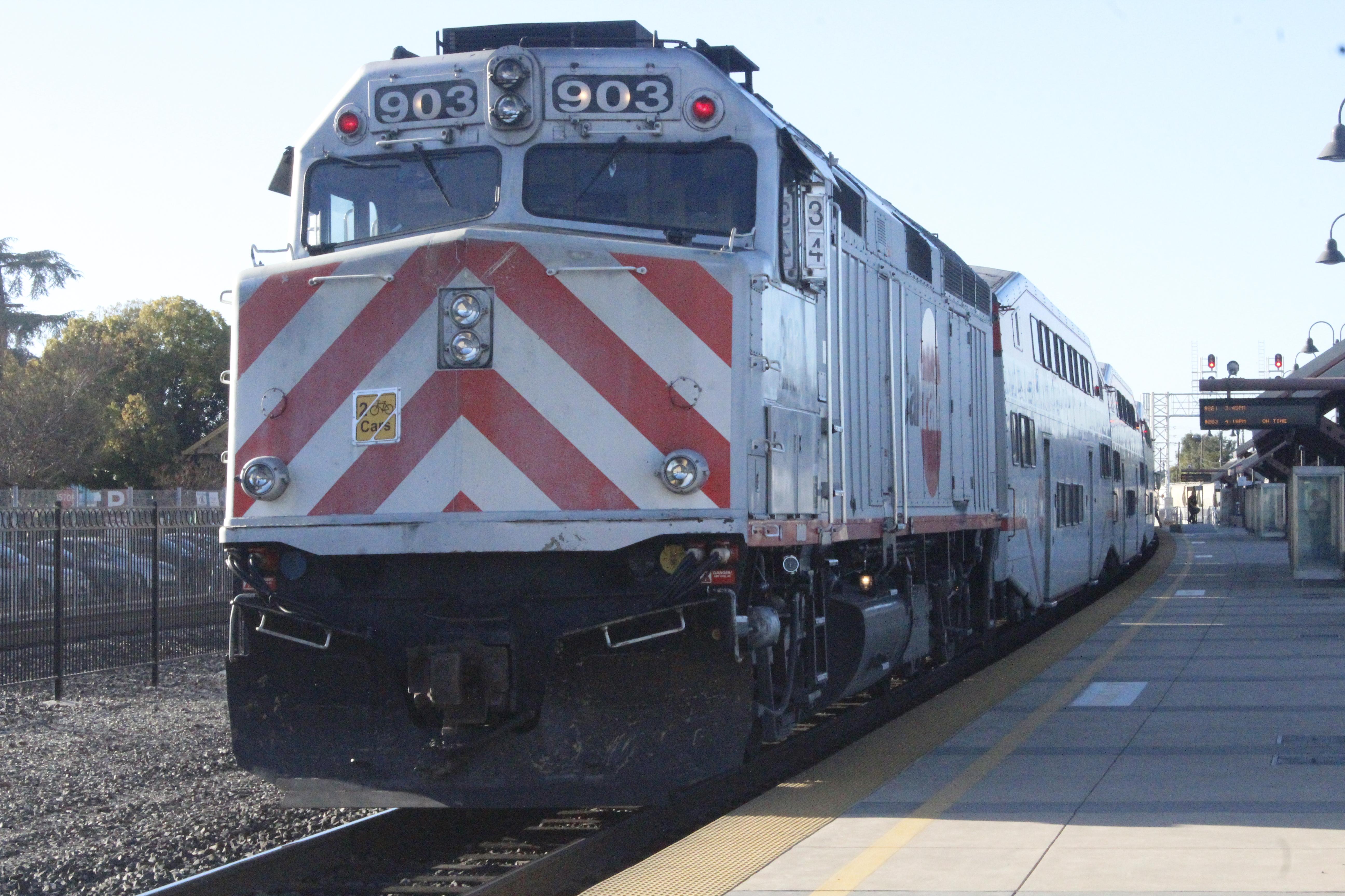 A Caltrain loco, unit 903, Santa Clara, acting as a trailer on a northbound train to San Francisco