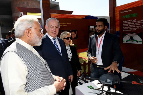 PM Netanyahu and his wife Sarah visit a technological exhibition, accompanied by India's PM Modi | by IsraelMFA
