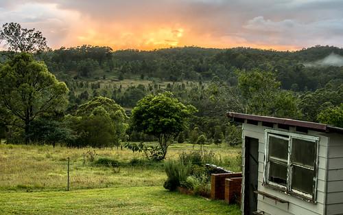 sunrise landscape shed green wet rain drops fence sun clouds bright sky mist fog nikon d7100 nsw australia