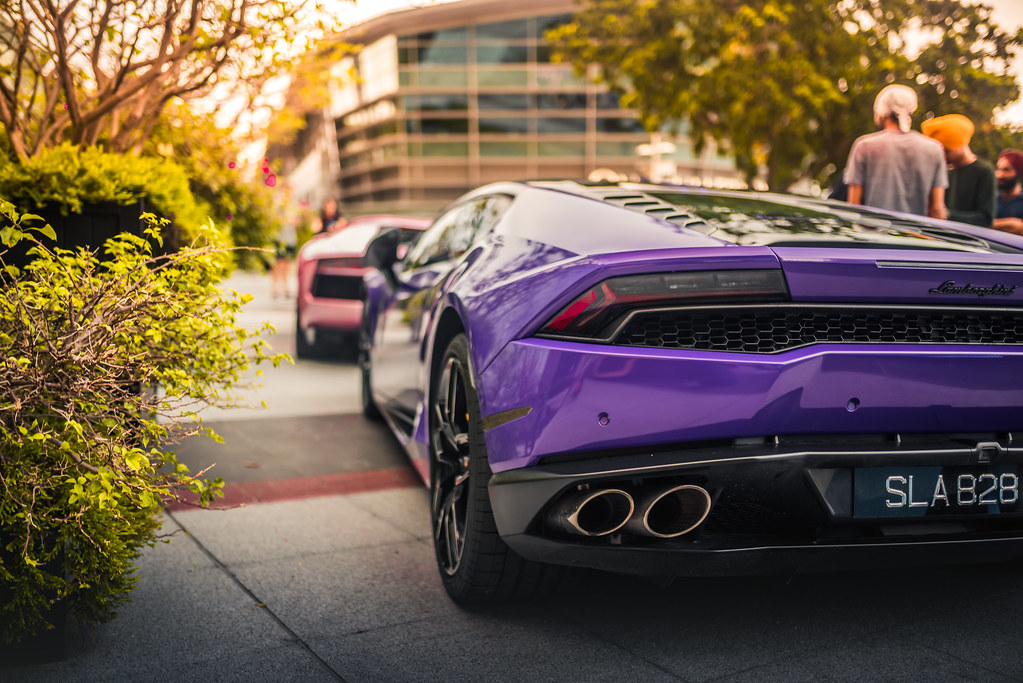Purple Lamborghini And A Pink One In Front Too Talha Farooqui