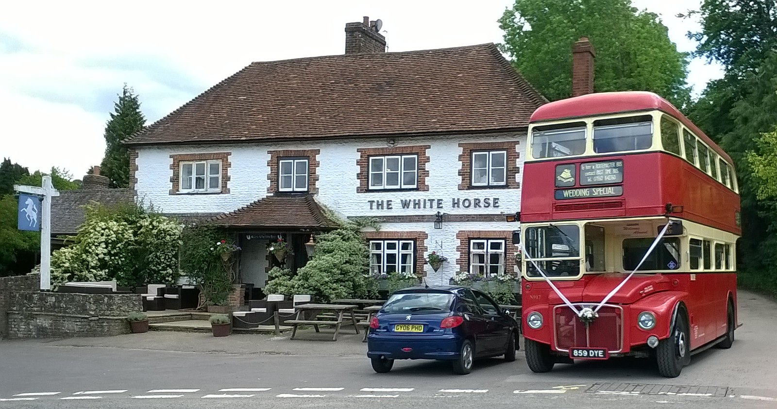 White Horse, red bus Wedding day in Hascombe, Surrey