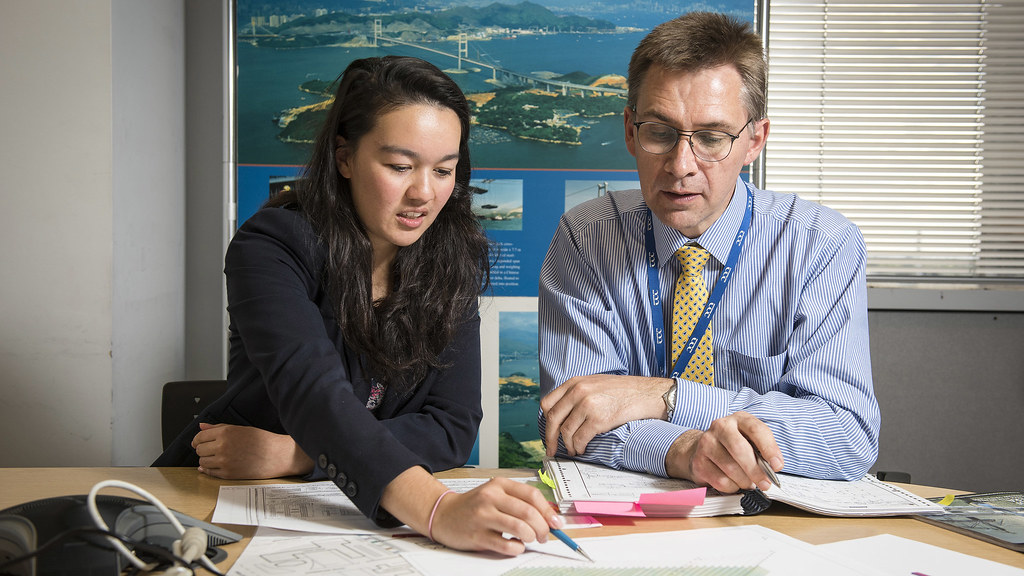 Image features a female student reviewing work with her supervisor.