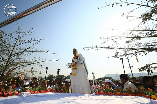 Arrival of Her Holiness on flower bedecked open carriage