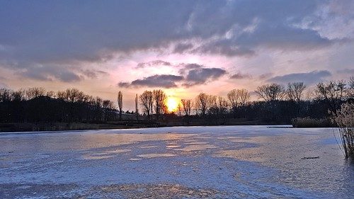 sunset clouds park warsaw ice frost winter february