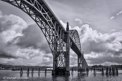 yaquinabaybridge newport oregon water ocean bay bridge pilings sky clouds blackandwhite monochrome bw highway101 nikon d90 oregoncoast sea