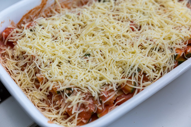 Zucchini, tomato sauce and grated cheese