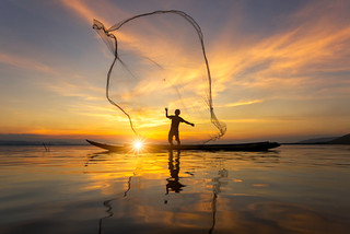Silhouette of Myanmar fisherman on wooden boat ,Myanmar fisherman in action catching freshwater fish in nature river, Myanmar traditional fishermen at the sunset near Inle lake,Myanmar | by c.collardjacques
