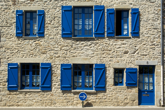 Blue sign and shutters