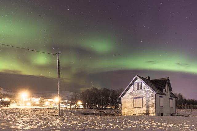 Aurora Borealis over old house