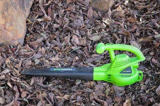 Greenworks electric leaf blower on pile of leaves | by yourbestdigs