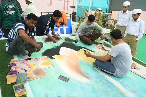 Devotees making rangoli