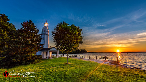 lighthouse water wisconsin clouds sunrise canon landscape pier us waves unitedstates horizon lakefront winnebago lakewinnebago landscapephotography neenah kimberlypointpark discoverwisconsin travelwisconsin 5dmarkiii andrewslaterphotography wicounties