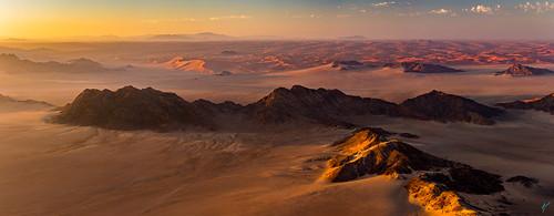 sossusvlei vancouverphotographer aaronvonhagen landscape hotairballoon aerialphotography aerial africa namibia adventureisoutthere wanderlust travel travelphotography sanddunes desert redsand mountains canon 5dmarkiii
