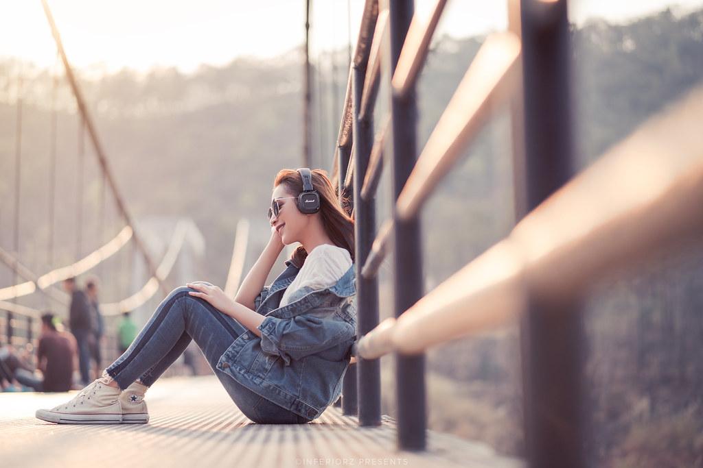 Young beautiful women listening music in headphones   Flickr